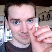 Me holding a tube of my first DNA vector prototype