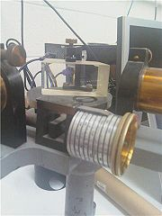 Figure 2: The inside of the constant-deviation spectrometer.  The interior prism and screw drive are visible. Photo credit: Alexandra Andrego, Junior Laboratory, Physics & Astronomy, University of New Mexico.