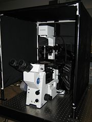 Front view of the enclosure and the microscope.