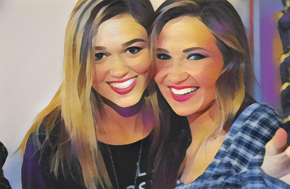 A Paintbrush painting of two beautiful girls smiling.