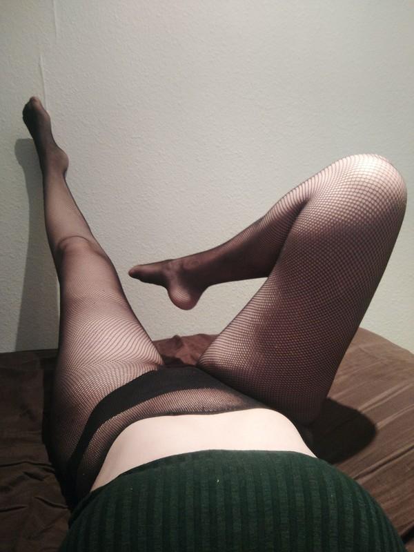 Fishnet tights tight around my body