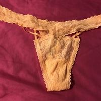 Small orange thong alone