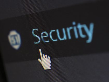 Finger cursor pointing to cybersecurity application logo