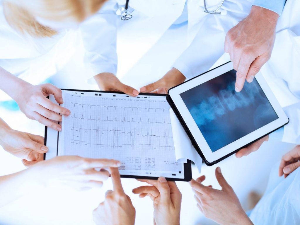 doctors using tablet smart device