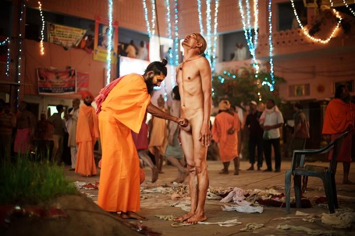 Naga sadhu smears bhasmi