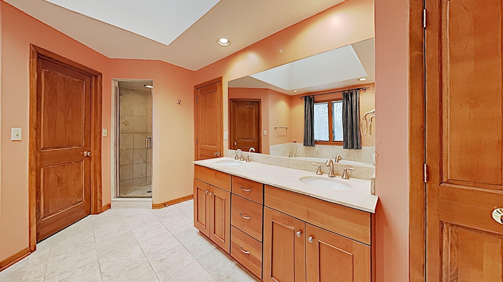 Granite vanity and tile shower