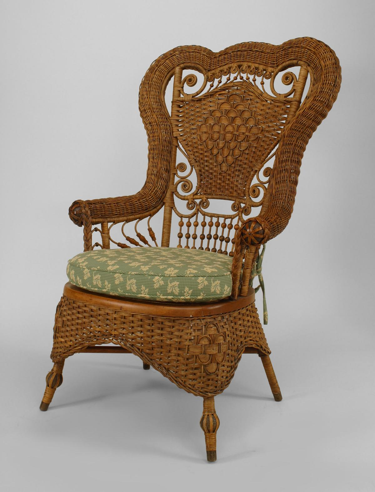 About Us American Victorian Natural Wicker Ornate Shaped High Back Arm Chair With Spindle Design Whitney Reed Chair Co Label