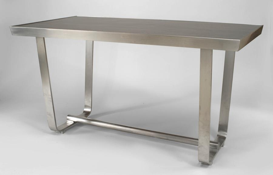 American 1940s aluminum center table with u shaped side supports connected with a tubular stretcher and inset brown lacqued wood top art deco