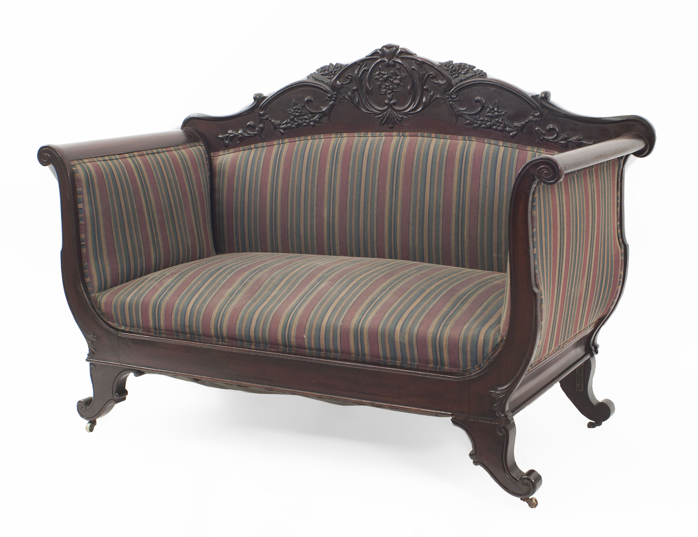 English Victorian loveseat with carved detail and blue and red striped ...