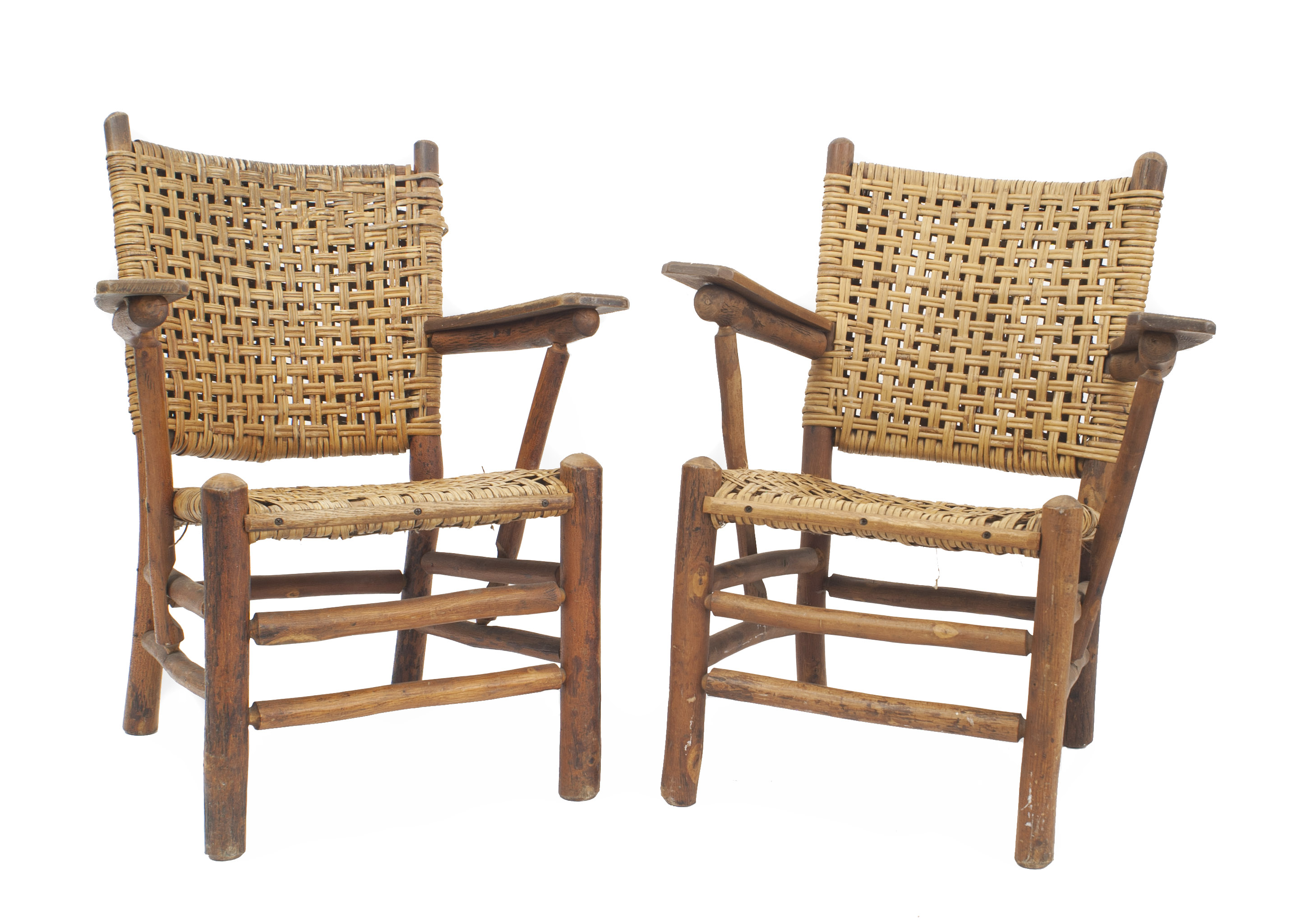 Pair of rustic old hickory bear wallow arm chairs with woven seat square back pine paddle form armrests a double box stretcher branded old hickory