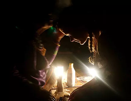 shipibo maestra curandera from the amazon jungle blows sacred tobacco over women during traditional ayahuasca ceremony in the sacred valley cusco peru, safe and reputable ayahuasca retreats with experienced facilitators and powerful integral healers.