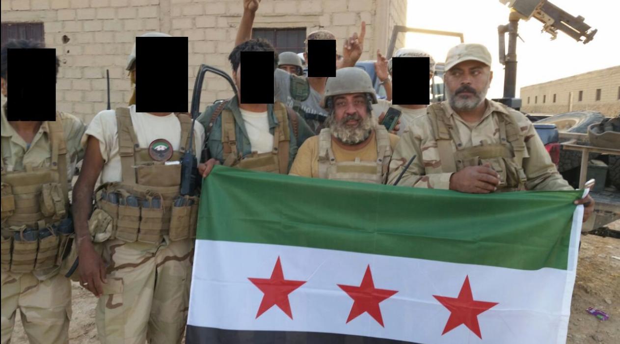 New Syrian Army troops. Third from right: Khaz'al al-Sarhan; Right: Lt. Col. Muhannad al-Talla'. Source: New Syrian Army Twitter.