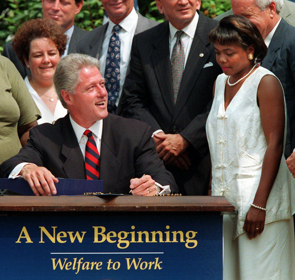 Clinton signing the Personal Responsibility and Work Opportunity Reconciliation Act of 1996.