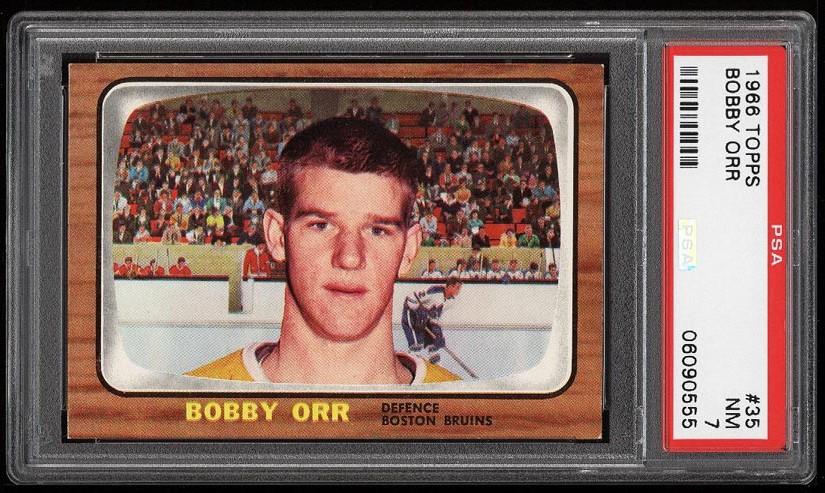 Image of: 1966 Topps Hockey Bobby Orr ROOKIE RC #35 PSA 7 NRMT (PWCC-HE)