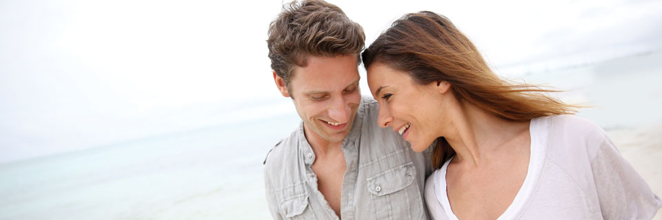 image of two people at the beach