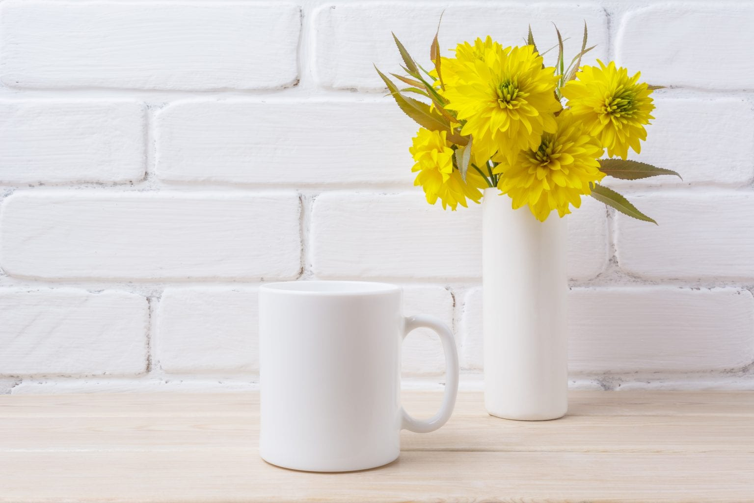 White coffee mug mockup with yellow rudbeckia Golden Ball flower. Empty mug mock up for design promotion.