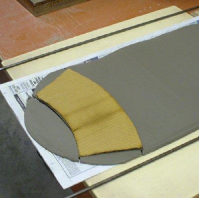 Preparing to make a glaze testing cone: cutting around the pattern