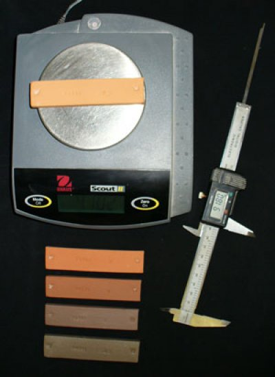 Scale, calipers and fired test bars to be measured for shrinkage
