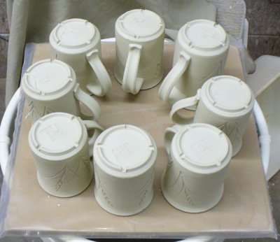 Place mugs with handles at the center and cover them during drying
