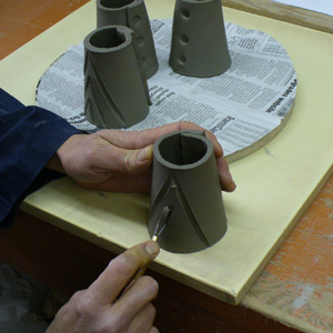 Making a glaze testing cone: Incising the surface to provide variation.