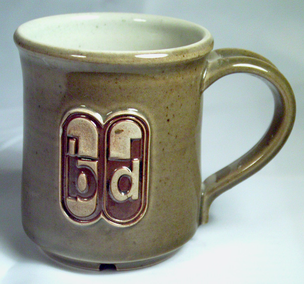 A mug with an embosses logo make by a letterpress stamp