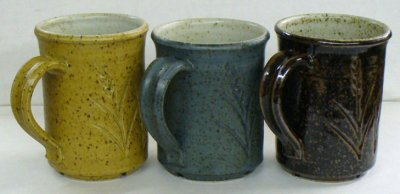 Three cone 10R mugs that have the same liner glaze.
