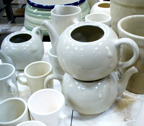 What often happens when already vitrified ware is refired?