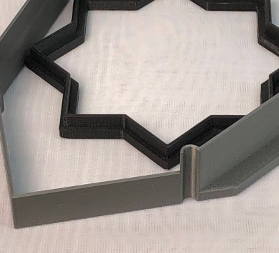 Two 3D printed cookie cutters, the one laminates the walls