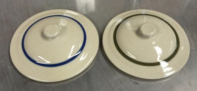 Same glaze, same clay, same cone 6 electric firing. Why is one speckled?