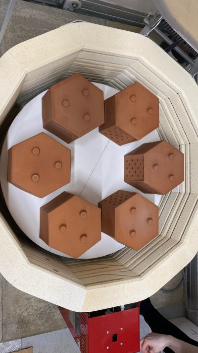 Hexagonal terra cotta planters in an electric kiln