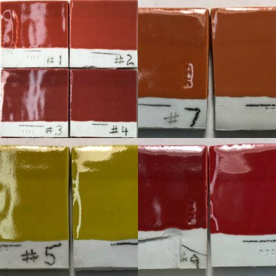 Cone 10R porcelain tiles with bright glossy reds, yellow, orange glazes