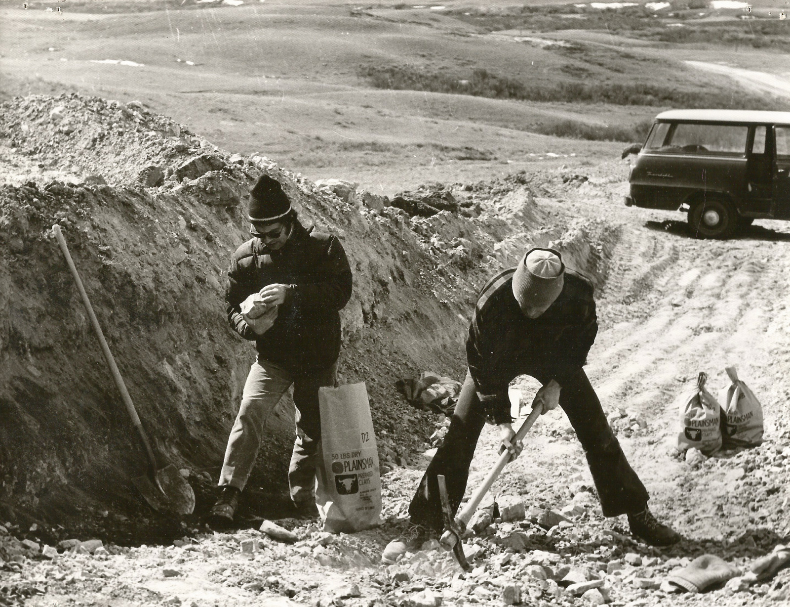 John Porter and Luke Lindoe taking lump clay samples from the side of a hill in southern Saskatchewa