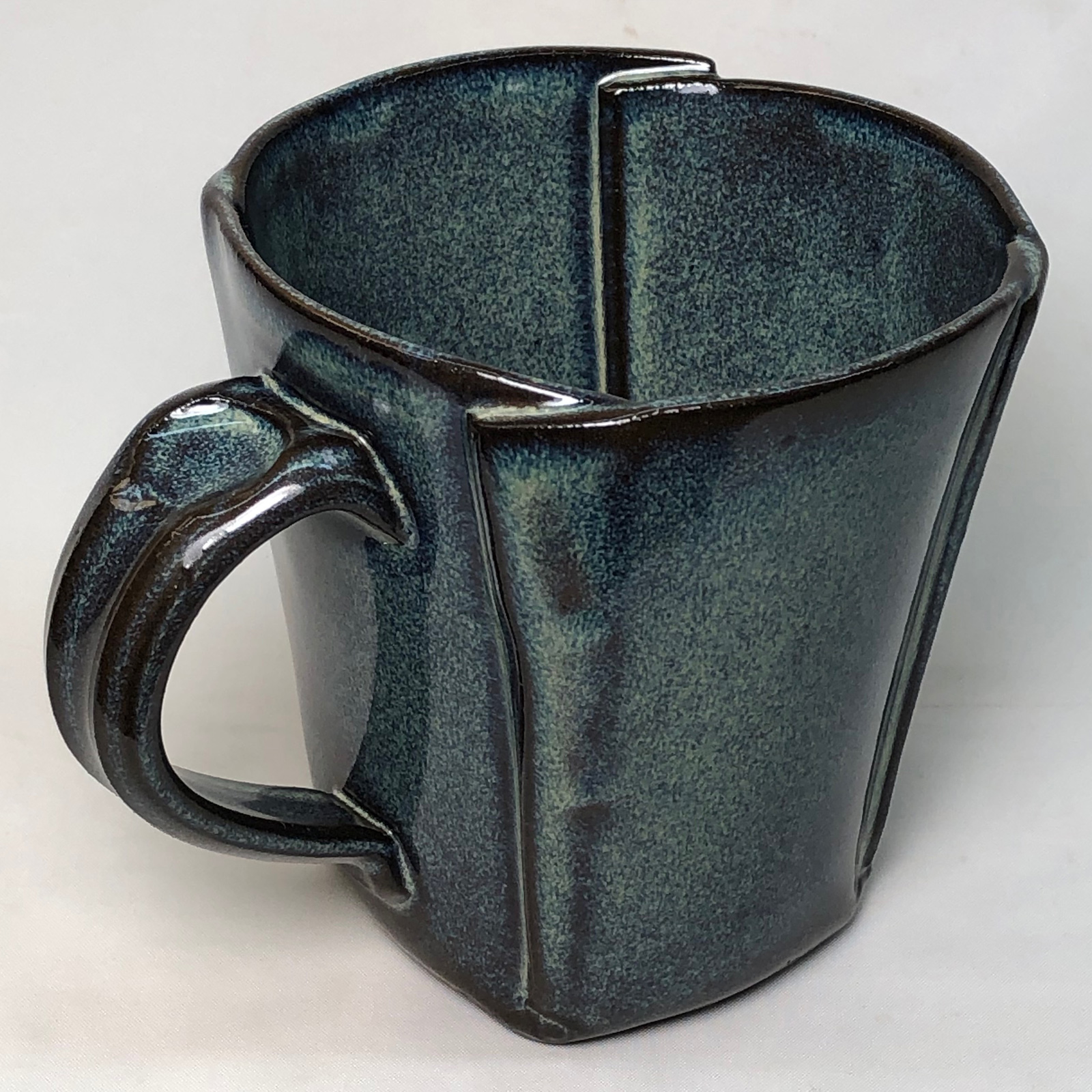 Cone 6 rutile blue glaze on a black porcelain body