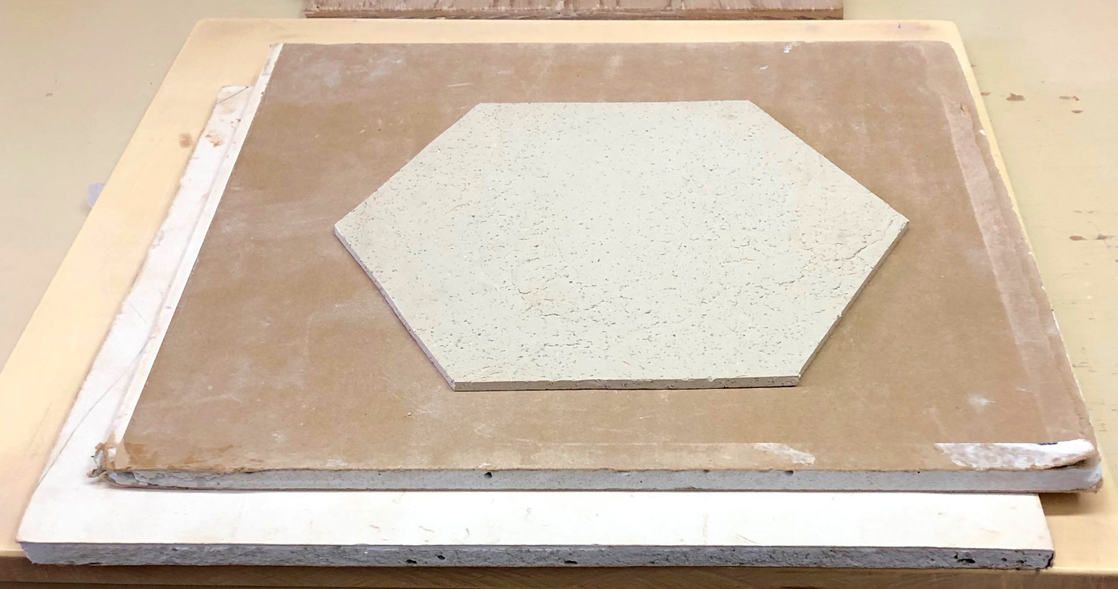 Drying a flat slab of clay between sheets of Gyproc