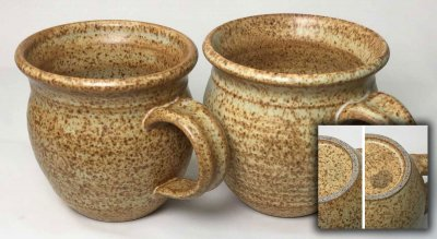 A pottery mug has a glaze the stains easily