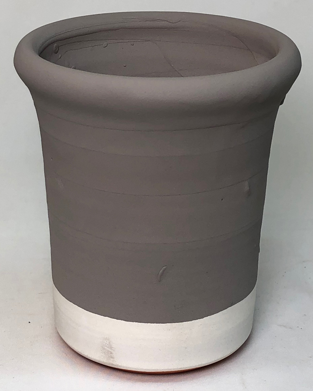 A small cup with multiple layers of glaze applied, and no cracks