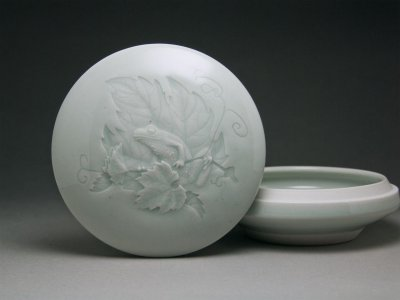 Just enough iron in this celadon to highlight the design