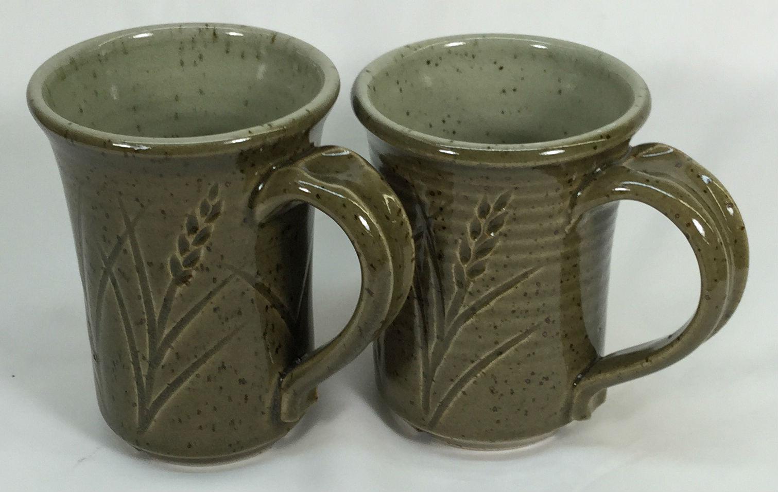 Plainsman H450 (left) vs. H550 celadon glazed mugs
