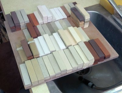 A batch of fired clay test bars in the Plainsman Clays lab