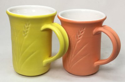 Yellow and orange porcelain mugs