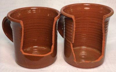Two clear glazed terra cotta mugs