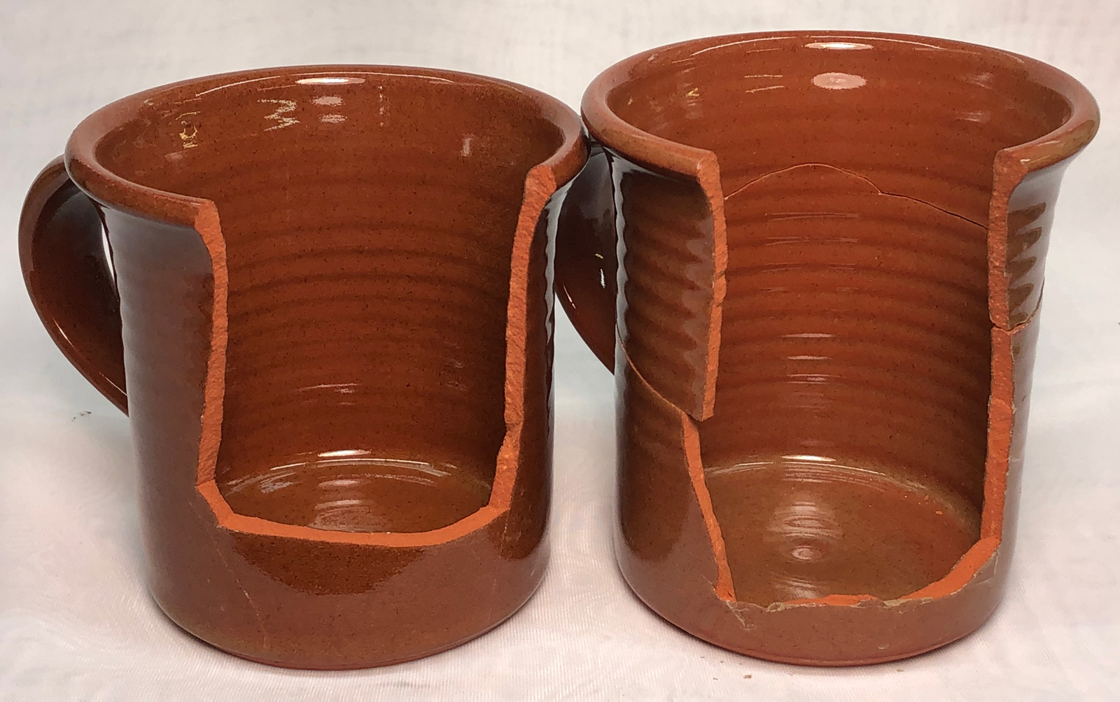 Two clear glazed terra cotta mugs