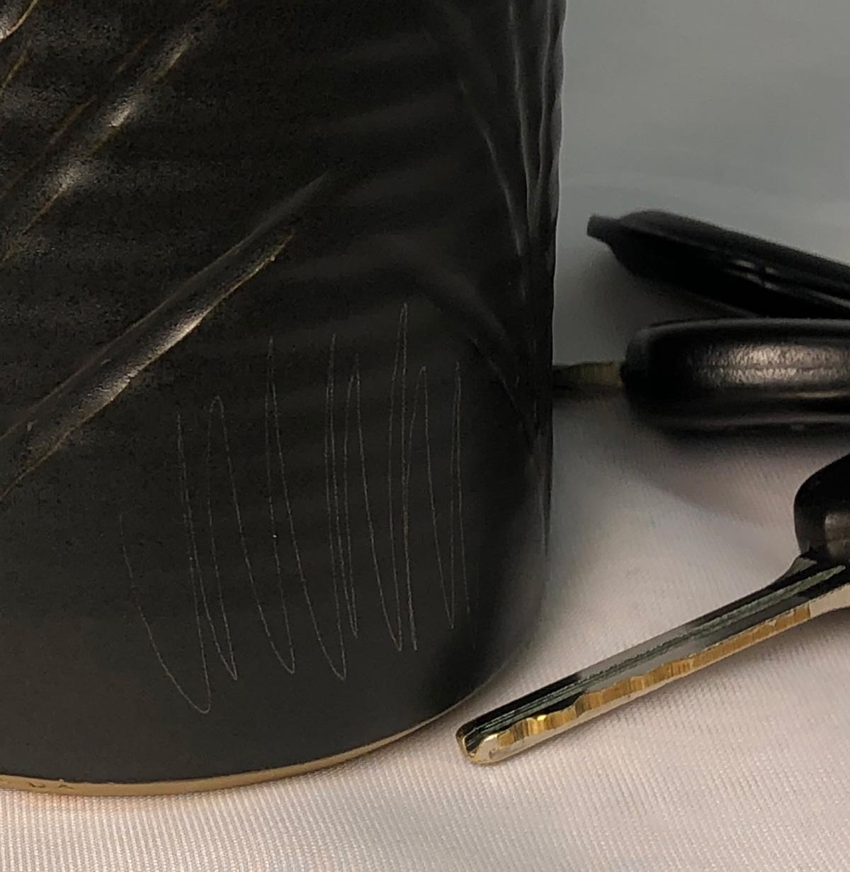 Cutlery marking on matte black glaze