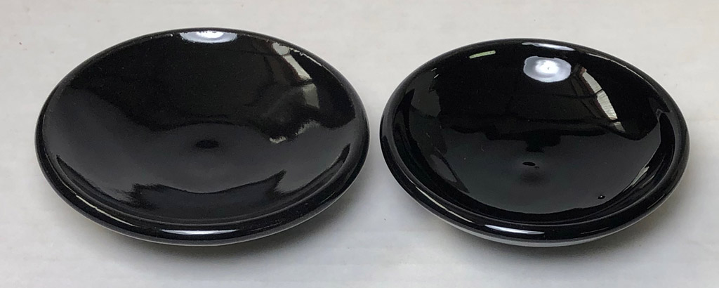 This cone 6 black glaze looks glossy until placed beside the cone 04 one