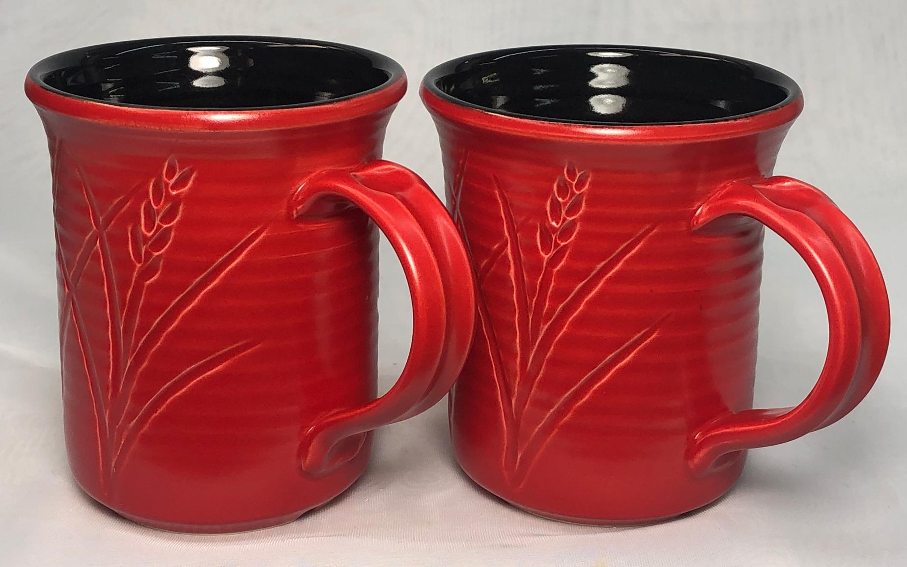 Two mugs, black glaze on the inside, red glaze on the outside