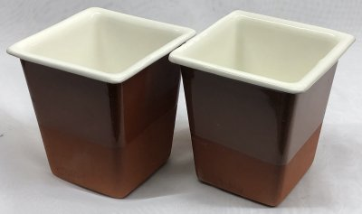 Two terra cotta slip-cast vessels with white inner surface