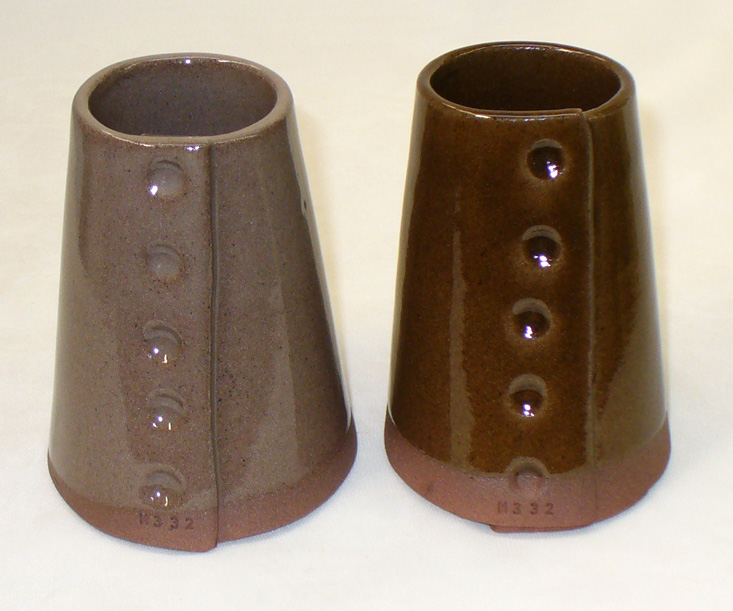 A typical transparent glaze vs. Alberta Slip amber base vs. a  on a red burning cone 6 body