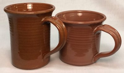 Two brilliantly transparent glazed terra cotta mugs