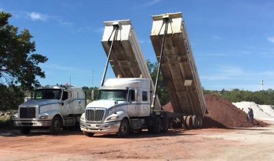 M2 clay being delivered to Plainsman Clays By tandem dump