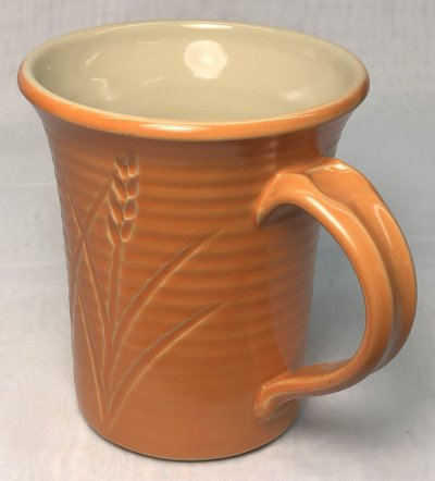 A hand made pottery mug that rivals the quality of industrial ware
